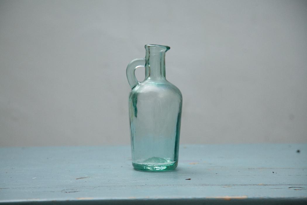 little glass jug